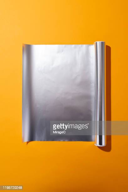 roll of opened aluminium foil - silver coloured stock pictures, royalty-free photos & images