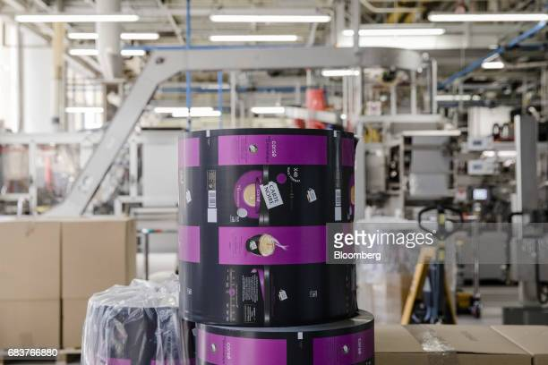 A roll of packaging for Carte Noire Corse coffee capsules sits inside the Carte Noire factory in Laverune France on Tuesday May 16 2017 The purchase...