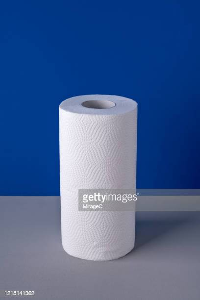 a roll of paper towel on blue - kitchen paper stock pictures, royalty-free photos & images