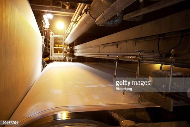 A roll of paper under goes its coating process at the Stora Enso OYJ paper mill in Imatra Finland on Wednesday May 12 2010 Stora Enso Oyj's outlook...