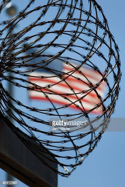 A roll of protective wire rings a detainee camp inside the US military prison for enemy combatants on October 27 2009 in Guantanamo Bay Cuba Although...