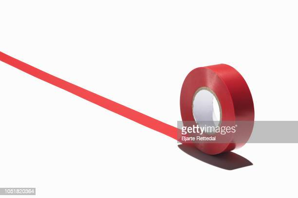 roll of red tape - bjarte rettedal stock pictures, royalty-free photos & images