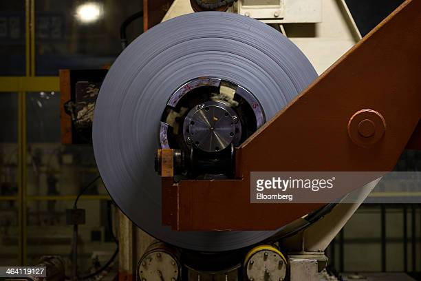 Roll of sheet steel sits in a steel-cutting machine at the Hyundai Motor Co. Factory in Asan, South Korea, on Monday, Jan. 20, 2014. Hyundai, South...