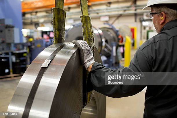 A roll of steel used for making Canadian coins arrives at the Royal Canadian Mint in Winnipeg Ontario Canada on Friday July 5 2013 The Canadian...