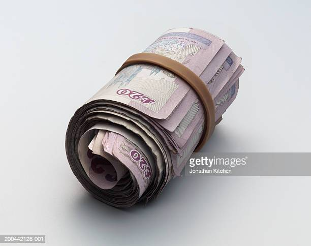 roll of twenty pound notes, close-up - british pound sterling note stock pictures, royalty-free photos & images