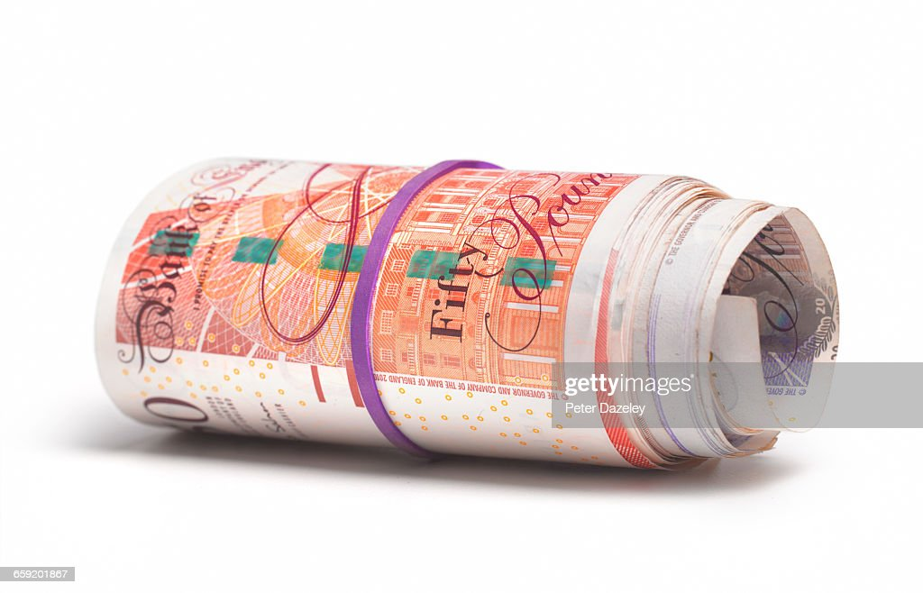 Roll of UK bank notes : Stock Photo