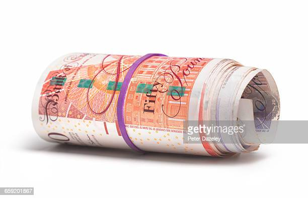 roll of uk bank notes - british pound sterling note stock pictures, royalty-free photos & images