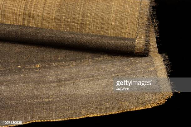 Roll of vintage horsehair cloth on black background