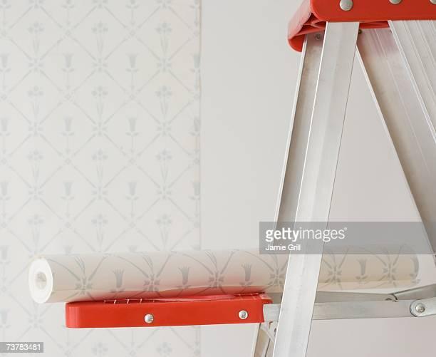 Roll of wallpaper on ladder shelf