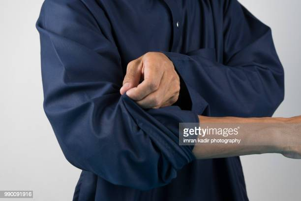 roll up the sleeves - long sleeved stock pictures, royalty-free photos & images