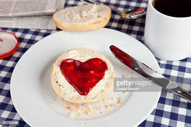 A roll with jam shaped in a heart