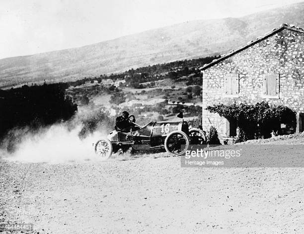 A RollandPilain cornering during the Mont Ventoux Hill Climb Provence France 1909 The car speeds round the corner trailing a cloud of dust A...