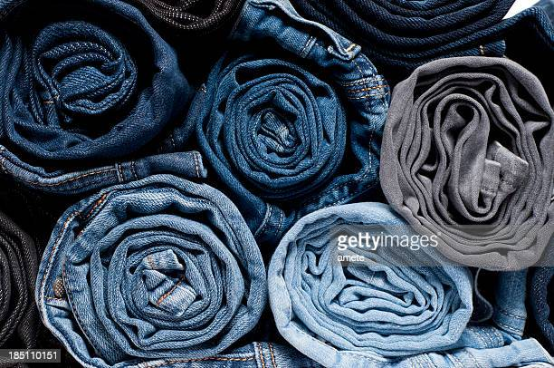 rolled denim jeans - rolled up stock pictures, royalty-free photos & images