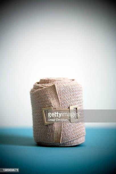 rolled elastic bandage - elastic bandage stock photos and pictures