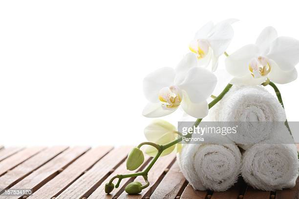 rolled face cloths on a spa bench - orchid flower stock pictures, royalty-free photos & images