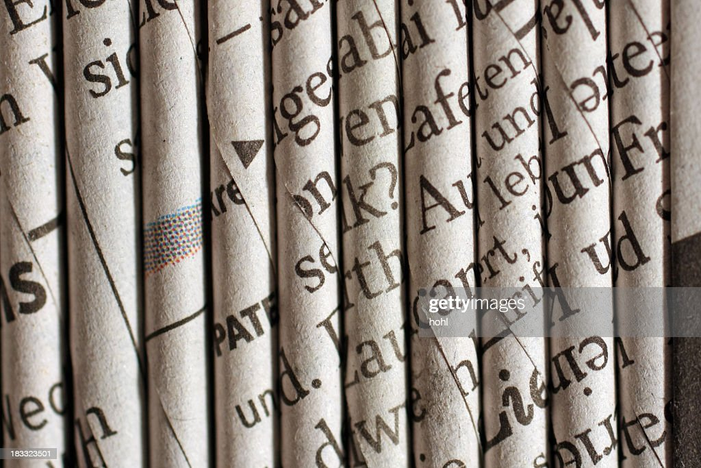 rolled newspaper pages : Stock Photo