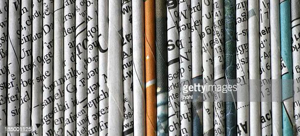 rolled newspaper pages