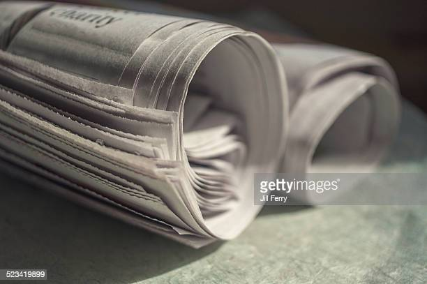 Rolled newspapers