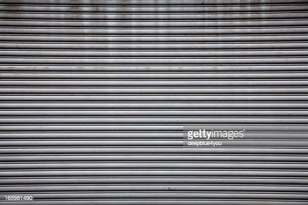rolled steel shutter door - industrial door stock pictures, royalty-free photos & images