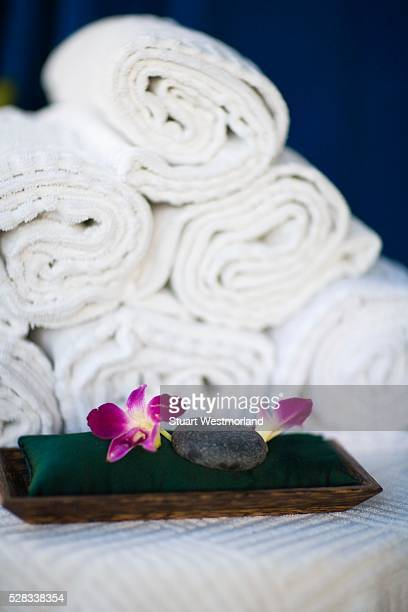 Rolled towels and spa rocks