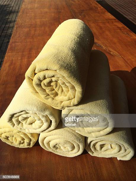 Rolled towels on wooden table
