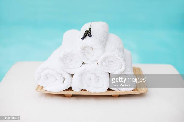 rolled towels with lavender on tray at poolside - towel stock pictures, royalty-free photos & images