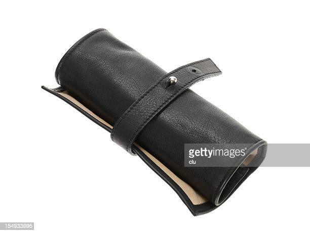 rolled up black leather pencil case closed - pencil case stock photos and pictures