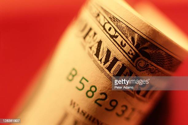 rolled up dollar bill - peter adams stock pictures, royalty-free photos & images