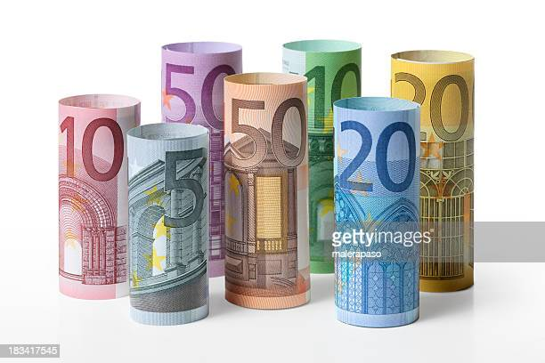 rolled up euro banknotes - five euro banknote stock photos and pictures