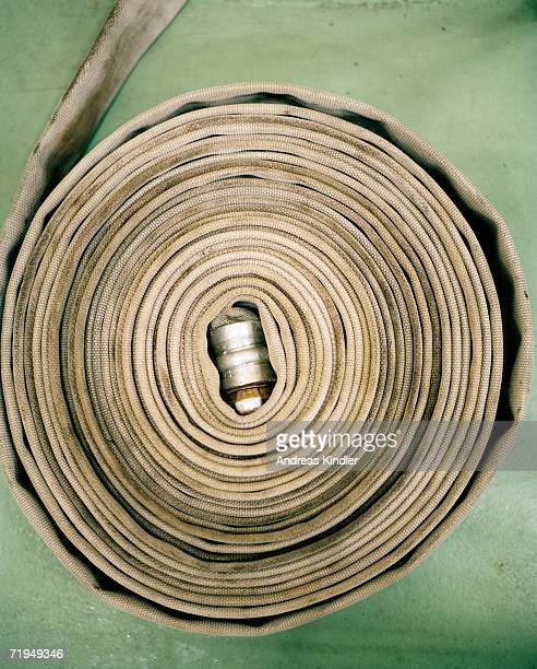 A rolled up fire-extinguishing hose.