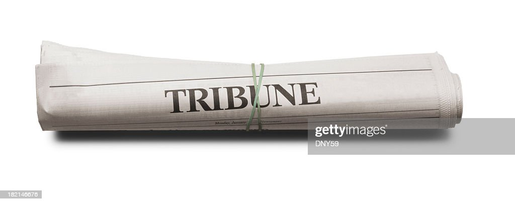 Rolled up newspaper on white background : Stock Photo
