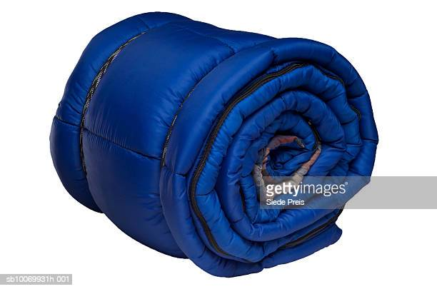 Rolled up sleeping bag on white background