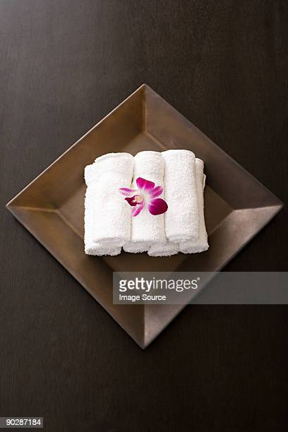 Rolled up towels and orchids