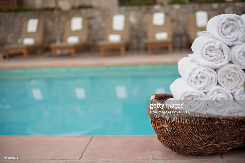 Rolled Up Towels Next To Swimming Pool Stock Photo - Getty ...