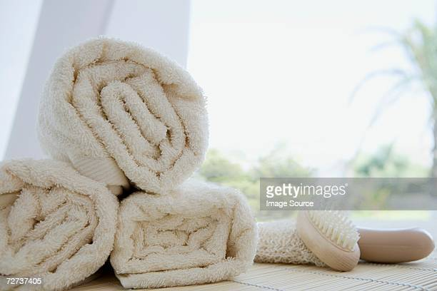 rolled up towels - loofah stock photos and pictures