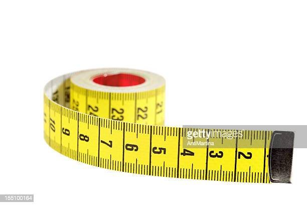 rolled yellow tape measure isolated on white