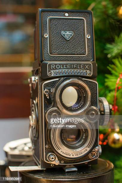 Rolleiflex 35E Planar TLR camera with viewing hood open and magnifier raised.
