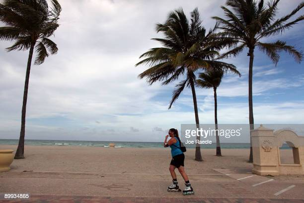 A roller blader passes the empty beach on August 19 2009 in Hollywood Florida An estimated 201 million people visited Florida from April through June...