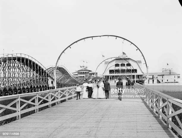 Roller Coaster along Boardwalk Leading to Casino, Lake Erie Park and Casino, Toledo, Ohio, USA, Detroit Publishing Company, 1905.