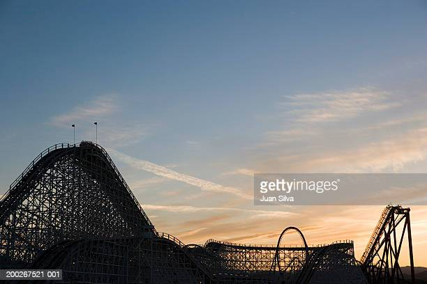 roller coaster at sunset - santa clarita stock pictures, royalty-free photos & images