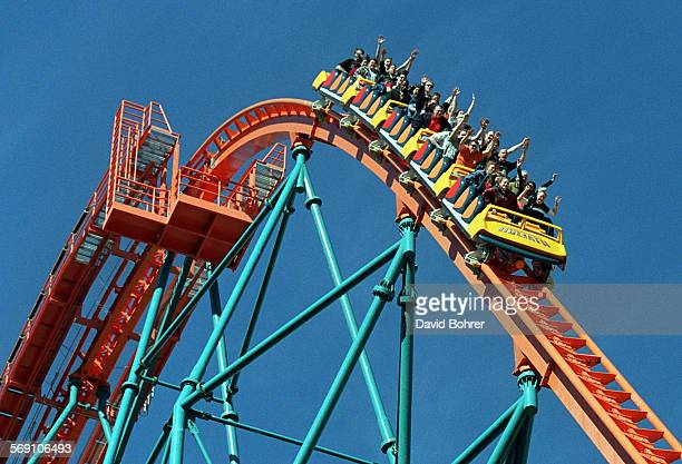 Roller coaster riders throw their hands in the air as they ride 'Goliath' the newest roller coaster at Six Flags Magic Mountain