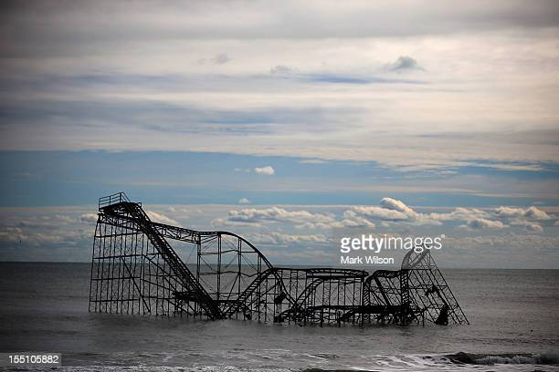 A roller coaster sits in the Atlantic Ocean after the Fun Town pier it sat on was destroyed by Superstorm Sandy on November 1 2012 in Seaside Heights...