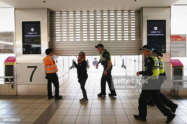 A roller door to train platforms gets shut down as striking Train Union workers at Flinders Street Station walk off the job on September 4 2015 in...