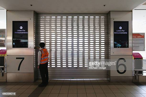 A roller door to train platforms is shut as striking Train Union workers at Flinders Street Station walk off the job on September 4 2015 in Melbourne...