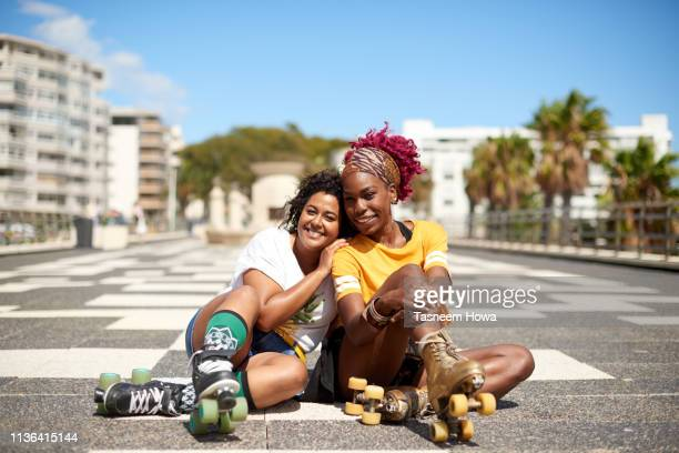 roller girls - showus stock pictures, royalty-free photos & images