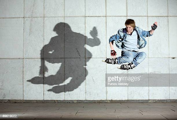 roller jumping - inline skate stock photos and pictures