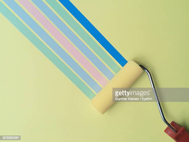 roller painting on green wall - paint roller stock pictures, royalty-free photos & images