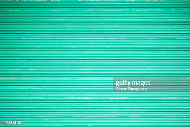 roller shutter background - roller shutter stock pictures, royalty-free photos & images