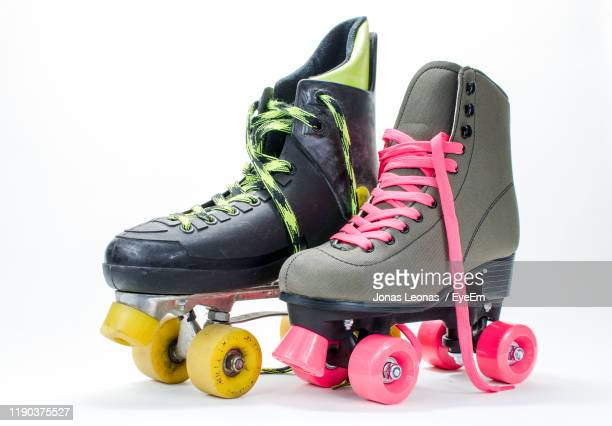 roller skate shoes on white background - roller skating stock pictures, royalty-free photos & images