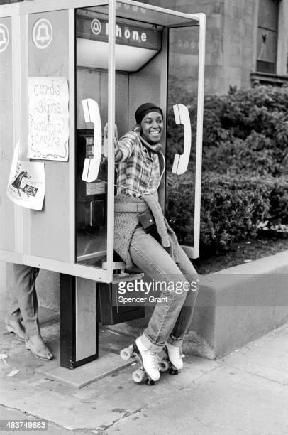 Roller skater phone caller on Boylston Street Boston Massachusetts 1975